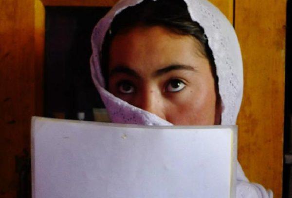 Afghan woman reading